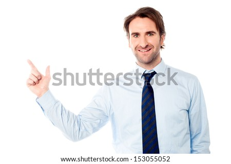 Business executive pointing at something - stock photo