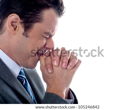 Business executive praying to god after business disappointment - stock photo