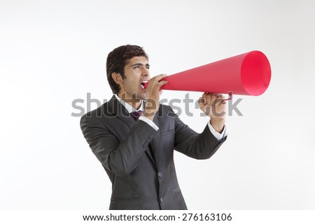Business executive speaking through a loud speaker