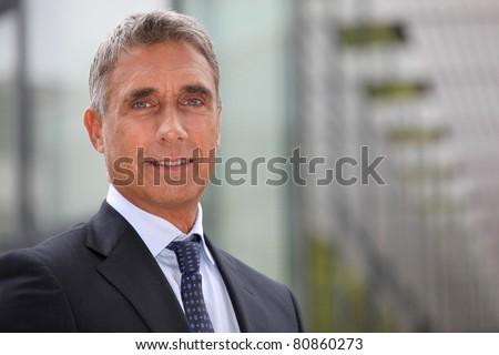 Business executive stood outdoors - stock photo