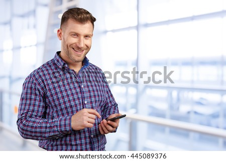 Business executive texting on his cell phone - stock photo