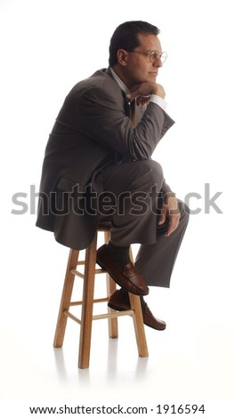 business executive thinking on stool