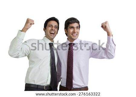 Business executives cheering - stock photo