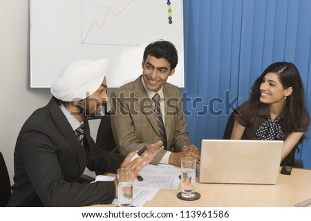 Business executives having a meeting in an office - stock photo