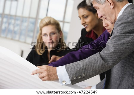 Business executives in a discussion. - stock photo