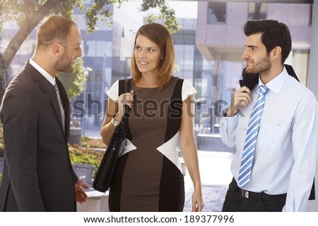 Business executives meeting on the street in front of office building. Suit and tie. - stock photo