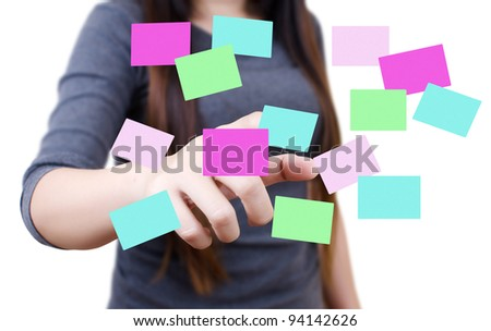 Business female pushing note paper on the whiteboard. - stock photo
