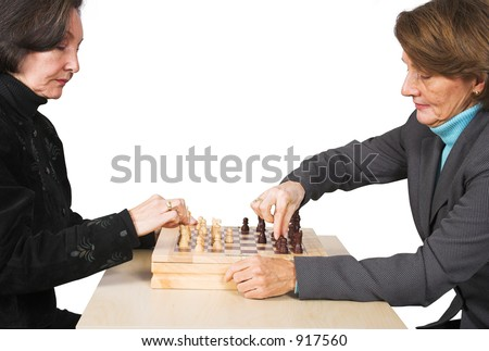 Business females playing chess over white - stock photo
