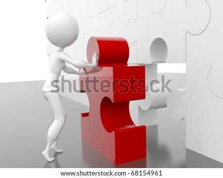 business figure building a puzzle - stock photo