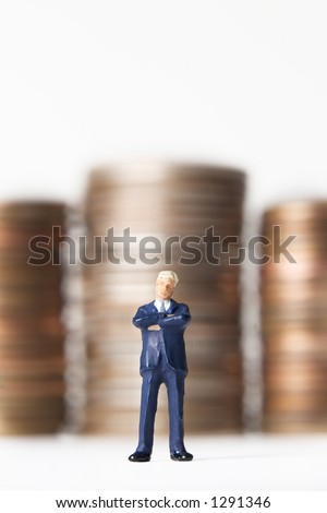 Business figure with money - stock photo
