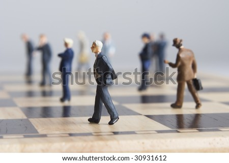 Business Figurine and chess - stock photo