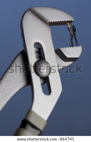 business figurine in a clamp - stock photo
