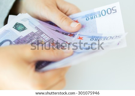 business, finance, saving, banking and people concept - close up of woman hands counting euro money - stock photo