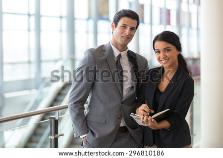 Business finance team young attractive members at the airport or convention event