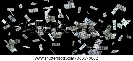 business, finance, waste and concept - close up of us dollar money flying over black background - stock photo