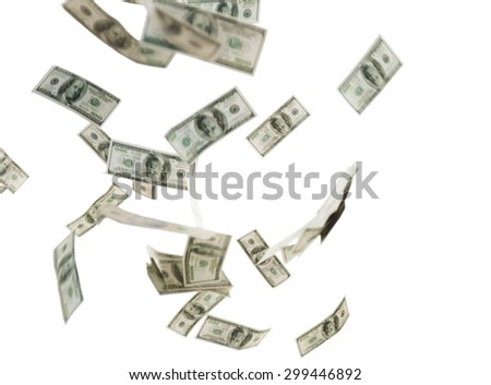 business, finance, waste and concept - close up of us dollar money flying over white background