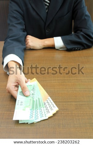 Business financial aid with focus on Korean Won bank notes  - stock photo