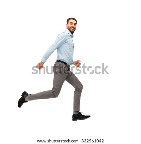 business, freedom, movement and people concept - smiling young man jumping or running away - stock photo