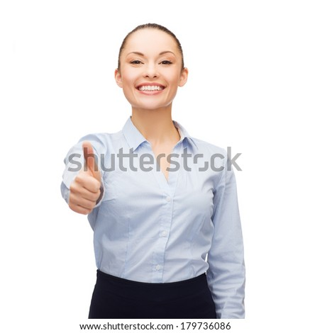 business, gesture and education concept - friendly young smiling businesswoman showing thumbs up - stock photo