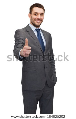 business, gesture and office concept - handsome buisnessman showing thumbs up - stock photo