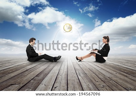 business girl and man get euro with laptop - stock photo