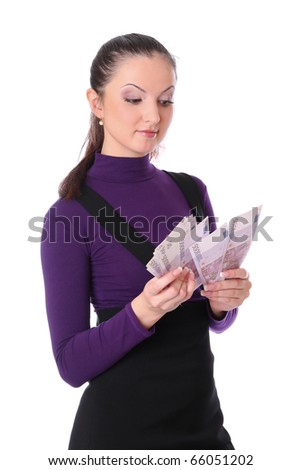 business girl is counting the money. Isolated at white background - stock photo