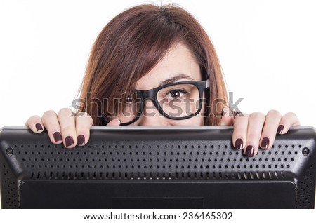 Business girl looking over computer at office wearing glasses - stock photo