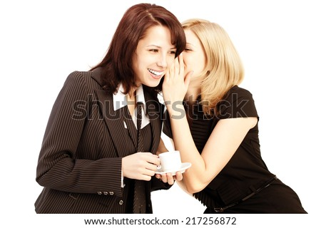 Business gossip. Women in the office. Two girls discuss the news at lunchtime with coffee. Gossip, rumors, secrets and intrigue - stock photo