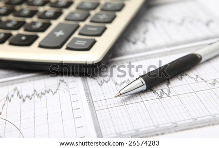 business graph, calculator & pen - stock photo