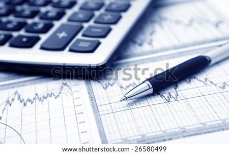 business graph, calculator & pen. Blue tone - stock photo