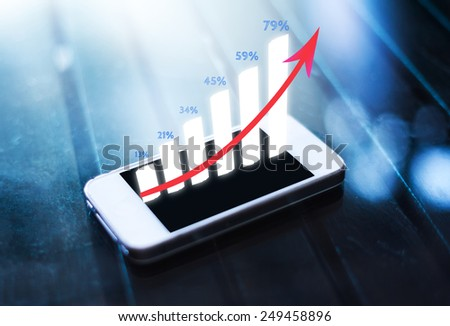 business graph on smart phone screen  - stock photo