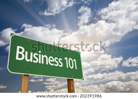 Business 101 Green Road Sign with Dramatic Clouds and Sky. - stock photo