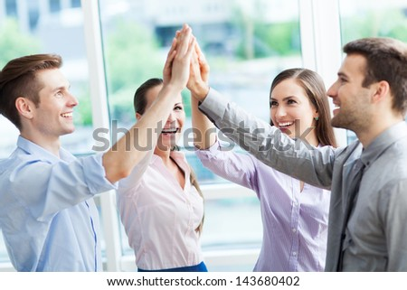 Business group joining hands - stock photo