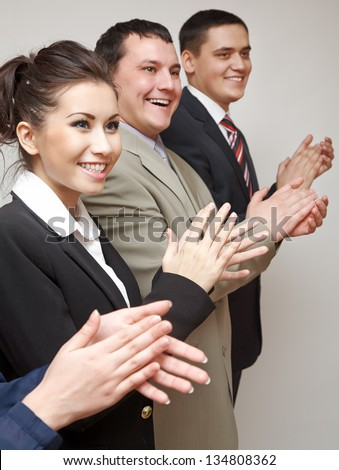 Business group of happy people clapping in line - stock photo