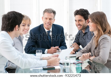 Business group of people discussing and working together at office - stock photo