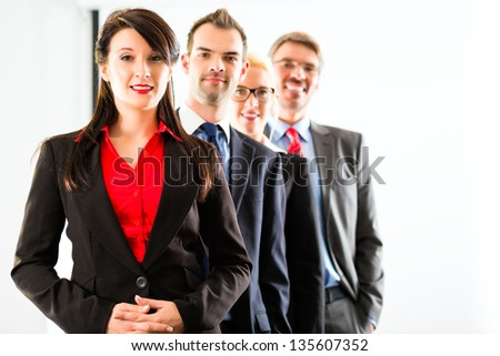 Business - group of successful businesspeople posing for group photo in office - stock photo