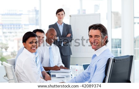 Business group showing ethnic diversity at a meeting - stock photo