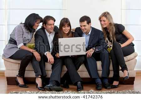 Business group with a laptop at the office - stock photo