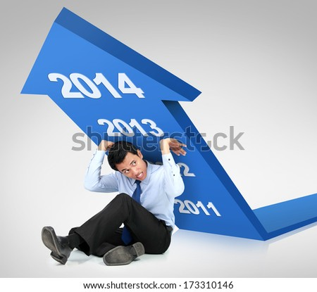 Business growth 2014. businessman trying to push arrow upwards - stock photo