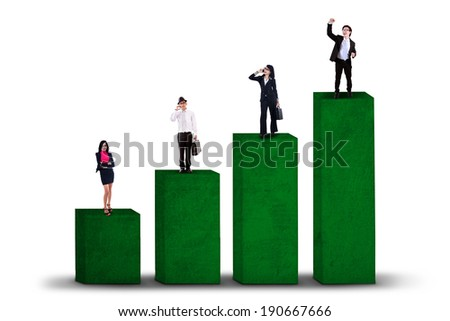Business growth concept with business group standing on business chart - stock photo