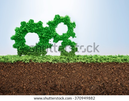 Business growth concept with grass growing in shape of gears  - stock photo