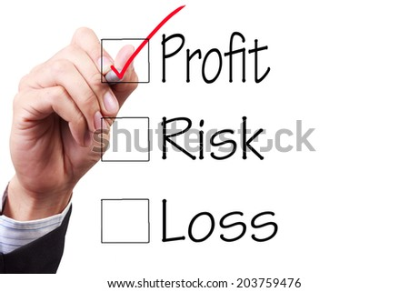 business hand checking the checklist boxes word profit risk loss with pen on transparent glass
