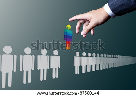 business hand choosing unique people - stock photo