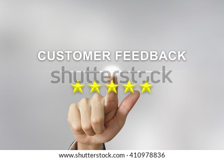 business hand clicking customer feedback with five stars on screen - stock photo