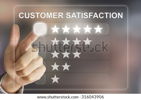business hand clicking customer satisfaction on virtual screen interface - stock photo