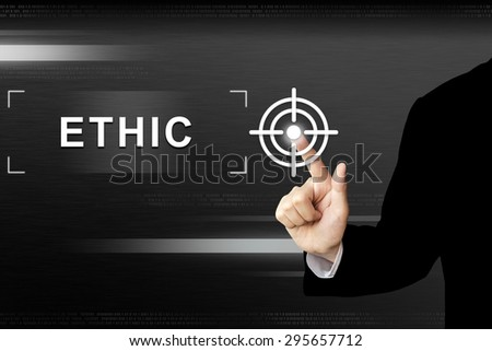 business hand clicking ethic button on a touch screen interface - stock photo
