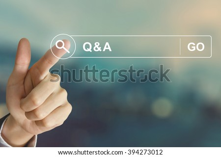 business hand clicking Q&A or Question and Answer button on search toolbar with vintage style effect - stock photo