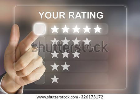 business hand clicking your rating on virtual screen interface - stock photo