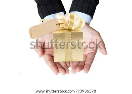 business hand for show gold gift box in her hand - stock photo