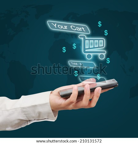 Business hand holding a smartphone with online shopping virtual screen. Concept of online business.